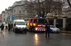 PHOTOS: Man threatens to set himself alight outside Leinster House