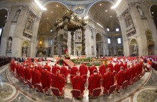 Why do Catholic cardinals wear scarlet for the conclave?