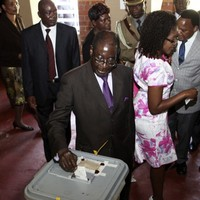 Zimbabweans vote on new constitution that would curb Mugabe's power