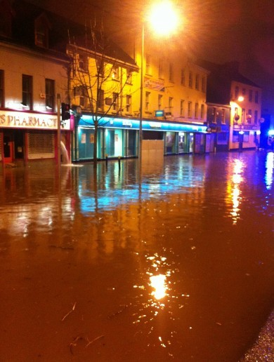 Flash floods and road warnings as heavy rain pours