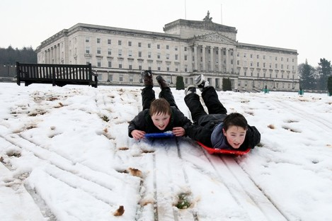 Andrew Hagan (left), and Dillon Lennox, both aged 11, enjoy the snow in the Stormont estate in Belfast yesterday.