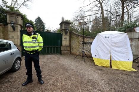 Police outside the home of Boris Berezovsky in Berkshire yesterday