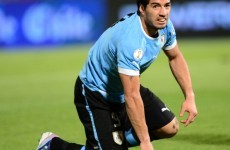 Luis Suarez punches Chile player