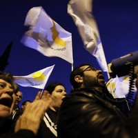 Cyprus says banks to reopen tomorrow with tight controls