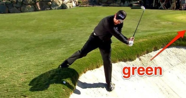 Phil Mickelson hits a ball onto the green while facing the opposite direction in another sick trick shot