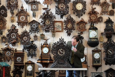 Roman Piekarski makes a start to changing the time on one of more than 600 cuckoo clocks at his Cuckooland Museum in Tabley, Cheshire before the clocks go forward on Sunday morning.