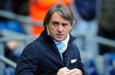 Which Manchester City player would Roberto Mancini like to punch?