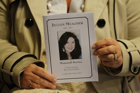 A mourner holds a booklet with Jill Meagher's face during a memorial Mass in her native Co Louth last October.