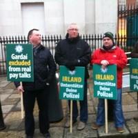 Garda protest outside EU finance ministers meeting in Dublin Castle