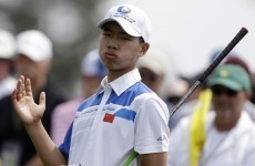 14-year-old Guan Tianlang pings an approach to 5-feet at US Masters