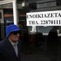 Cyprus eases controls on stricken banks - but keeps €300 withdrawal limit