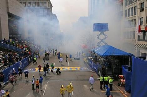 Boston Globe photographer David L Ryan captured the immediate aftermath of the blasts at Boylston Street in central Boston.