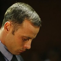Police took photos of Oscar Pistorius on their mobile phones after arrest