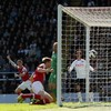 Mertesacker heads Gunners into 3rd after two red cards