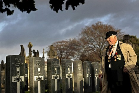 Tommy McKenzie from Dublin who served with the Australian Army pays his respects at 43 headstones for Irish servicemen and women from both World Wars who lie in unmarked graves in the cemetery