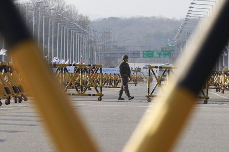 A South Korean army soldier patrols at Unification Bridge, which leads to the demilitarised zone separating North and South Korea.