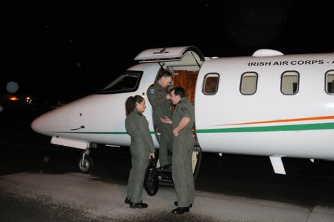 Captain Ed Hollingsworth, Captain Niall Goff and Airwoman Ashley Stafford prepare for their flight from Baldonnel last night.
