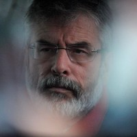 Adams to meet family of prison officer shot dead in Dublin
