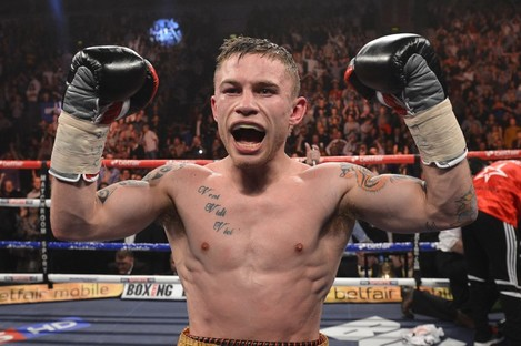 Carl Frampton celebrates his victory over Kiko Martinez in February.