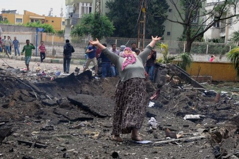 A woman cries at the scene of one of the explosion sites.