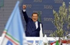 Thousands attend rally for Berlusconi - despite his conviction for tax fraud