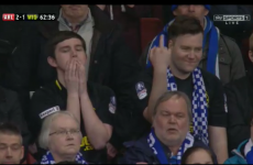 This unhappy Wigan fan expressed himself through the language of bird-flipping on TV
