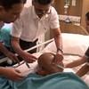 Successful life-saving surgery on baby's rare, swollen head disorder