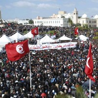 Tunisia to hold elections by mid-July as protests continue