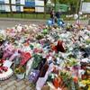 London police arrest three more over drummer's murder