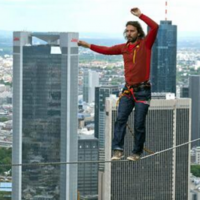 An Austrian man tip-toed along a line strung 185 metres off the ground yesterday