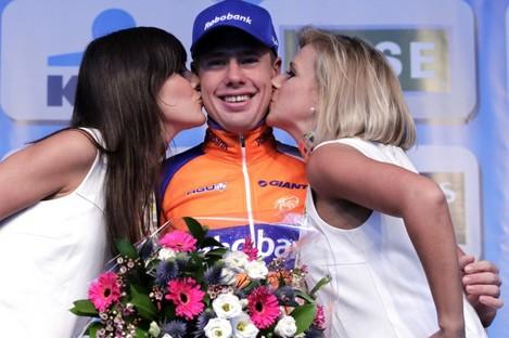 Netherlands cyclist Sebastian Langeveld is congratulated after winning the Belgian cycling classic 'Omloop Het Nieuwsblad'.