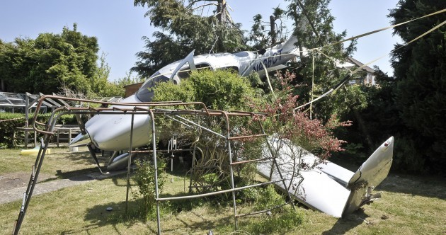 PHOTOS: Plane crashes into someone's back garden - and somehow, nobody is injured