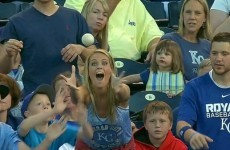 Little kid steals a baseball from a very excited woman