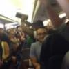 Passengers stuck on overheated plane take dramatic action