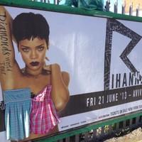 Someone has been stapling dresses to Rihanna's naked Dublin billboards