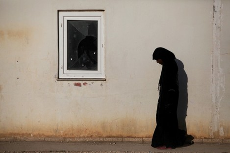 A displaced Libyan Tawargha woman is seen in a refugee camp in the outskirts of Benghazi.