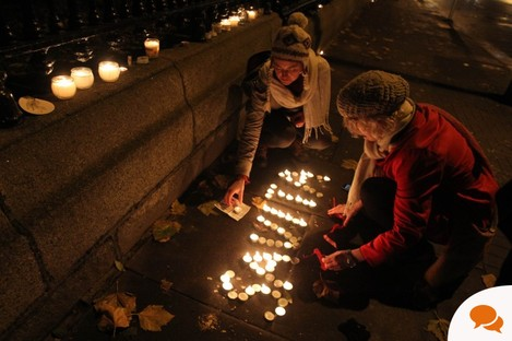 Candles are left in tribute outside Leinster House in Dublin, after thousands of people marched demanding legislation on abortion after the death of Indian woman Savita Halappanavar last year.
