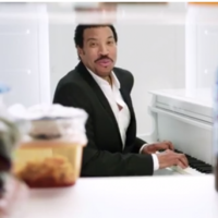 WATCH: Lionel Richie sings in a fridge and serves beer