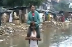 Indian journalist defends TV report filed from shoulders of flood survivor