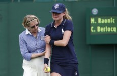 Wimbledon ball girl leaves court in tears after getting hit with a 128mph serve