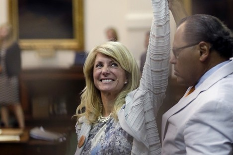 Wendy Davis points to supporters as times expires and her marathon filibuster comes to an end