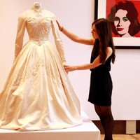 Sold! Elizabeth Taylor's wedding dress, Cobain's guitar and Bond's watch