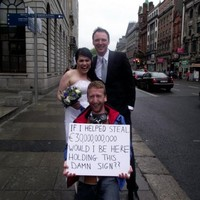 Newlyweds take photos at Anglo protest