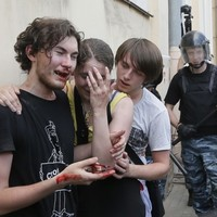 Putin signs new law punishing people for 'homosexual propaganda'