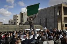 Gaddafi regains opposition-help city, but rebels gain oil port