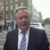 Video: Howlin angrily pushes camera away as he is confronted over bank inquiry