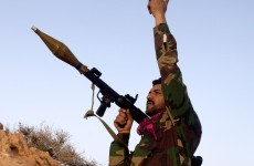 Heavy gunfire heard in Tripoli as pro-Gaddafi forces claim gains in Libya
