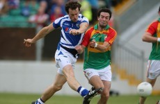 Laois player Padraig McMahon crowns a 50-yard run with a great individual goal