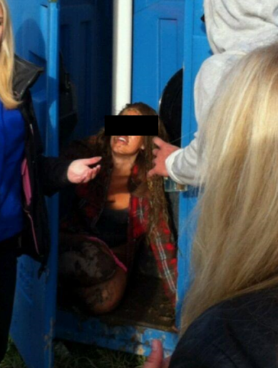 Girl falls face first into festival portable toilet