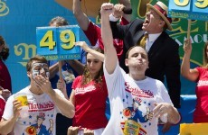 Man scoffs 69 hot dogs, breaking own record